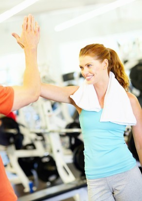 High Five Happy Women at the Gym