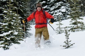 guy running on snowshoes