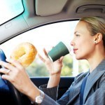 Businesswoman Driving to Work and Having Breakfast