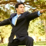 Businessman Stretching Arms At Park