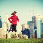 women running with smartphone in new york city