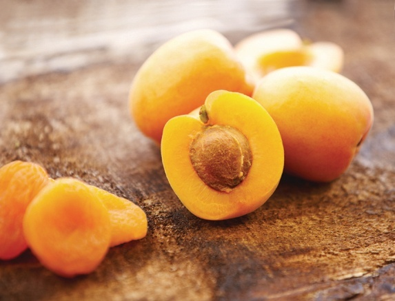 sliced fresh and dried apricots on a cutting board