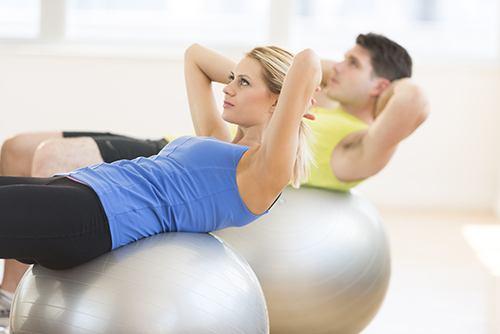 women on an exercise ball