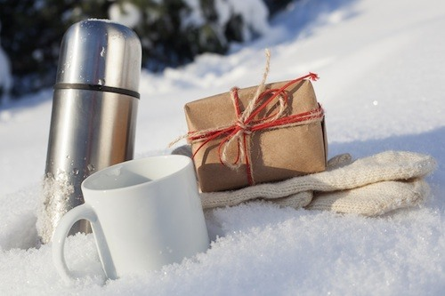 thermos cup and gift in the snow