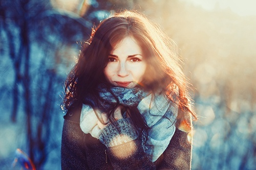 content brunette woman in the sunshine and snow