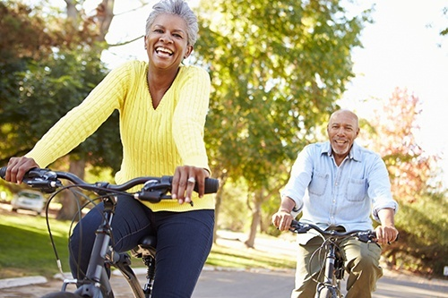 retired man and woman on bikes