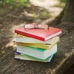 Stack of books with reading glassess
