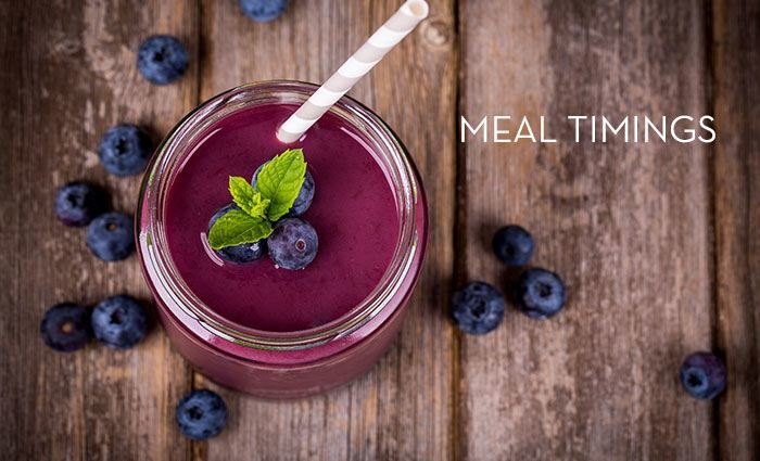 a blueberry smoothing in a jar with the words Meal Timings