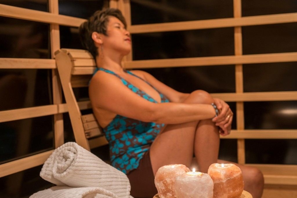 a woman in an infrared sauna detoxing