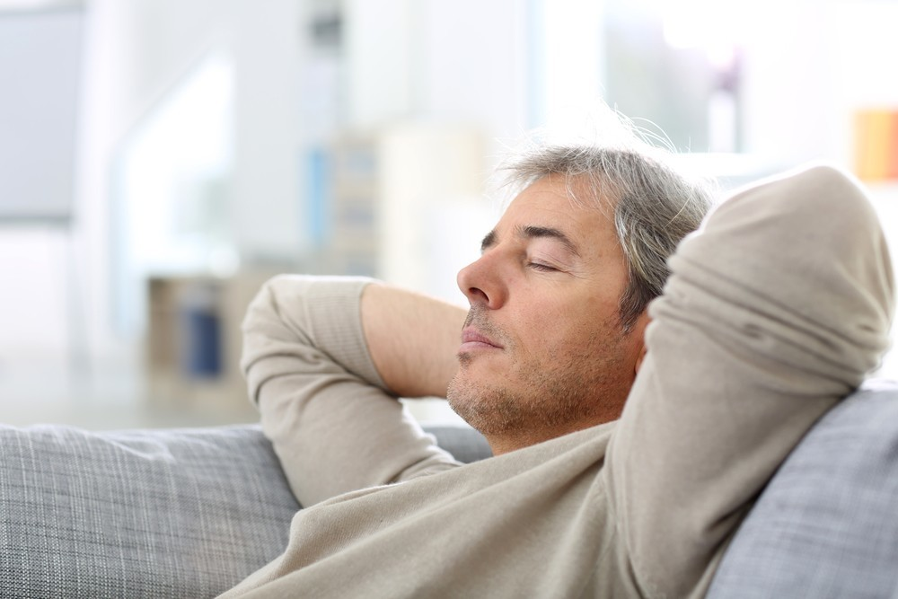 a man taking a nap on a couch