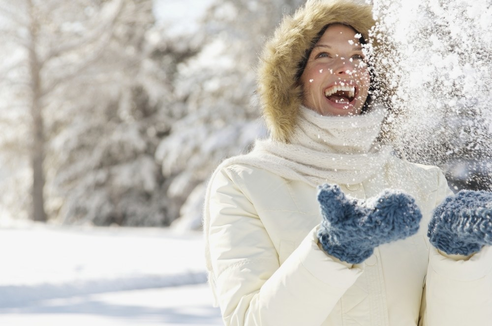 a woman playing in the snow