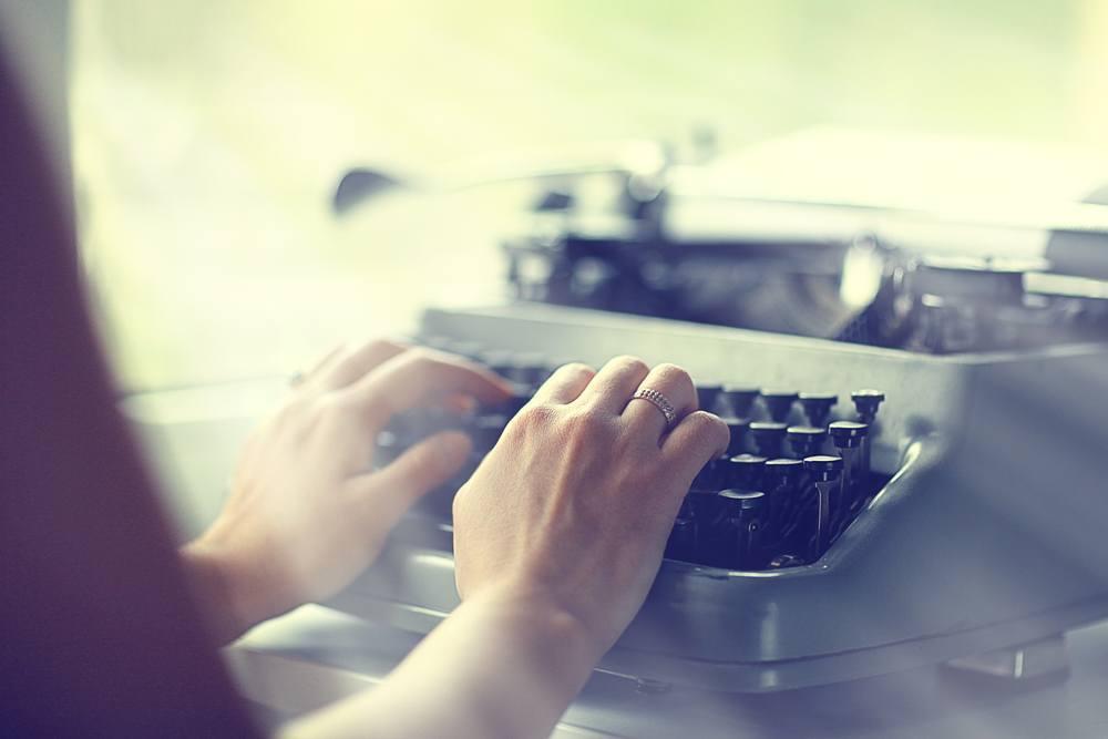 someone writing on a typewriter