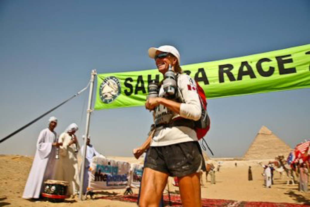 A woman crosses the finish line after 250km across the Sahara desert