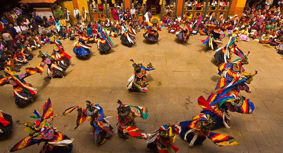 Dancers at the Paro Tsechu Festival or Spring Festival experienced on Mountain Trek Adventure Trek