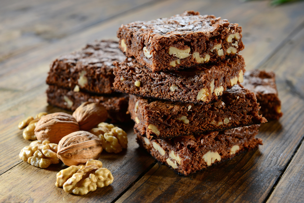 black bean brownies stacked with a walnut