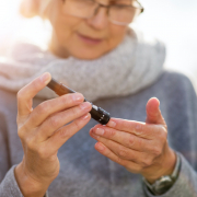 older woman with diabetes checking blood sugar levels