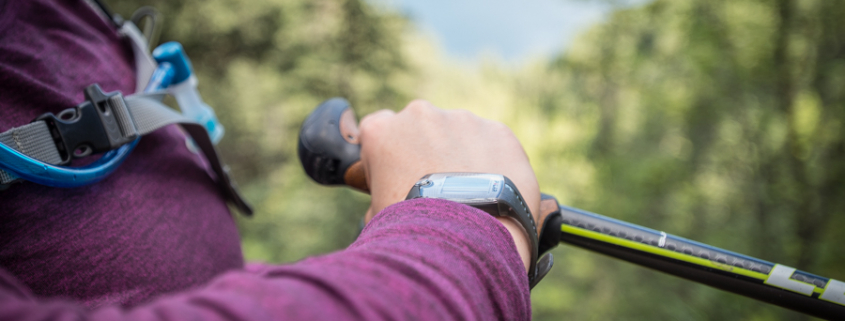 looking at wrist watch in nature