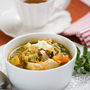 bowl of soup with garnish and napkin