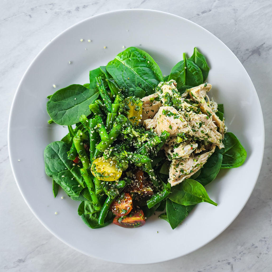 Healthy vegetable salad with leftover turkey on plate