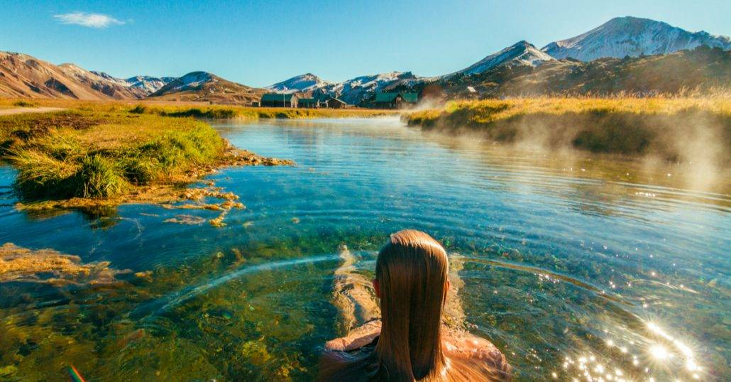 woman sitting in a Hot Spring Canada