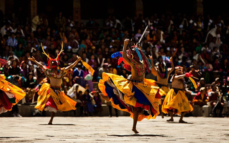 Masked dancers at the Paro Tsechu Spring Festival seen on Mountain Trek Adventure Trek