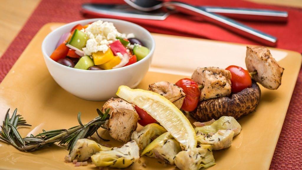 Skewered Greek Chicken on Portobello Mushrooms with Artichokes