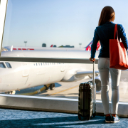 Woman traveller looking at plane