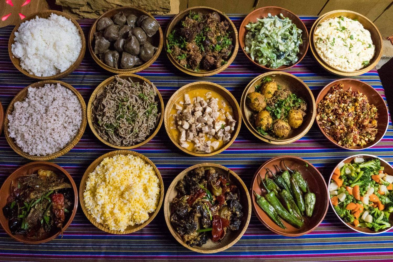 an array of common bhutanese dishes on a table
