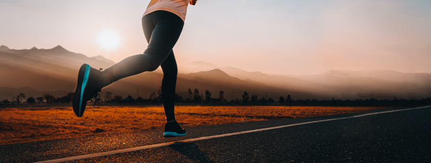 woman running outside with beautiful summer evening in the mountains